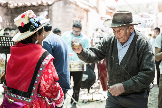 Ancash, Peru - September 13, 2019: Peruvian older man dancing during a traditional religious celebration