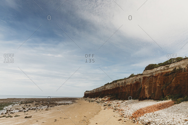 View of Red and White Cliffs at Hunstanton against a cloudy sky
