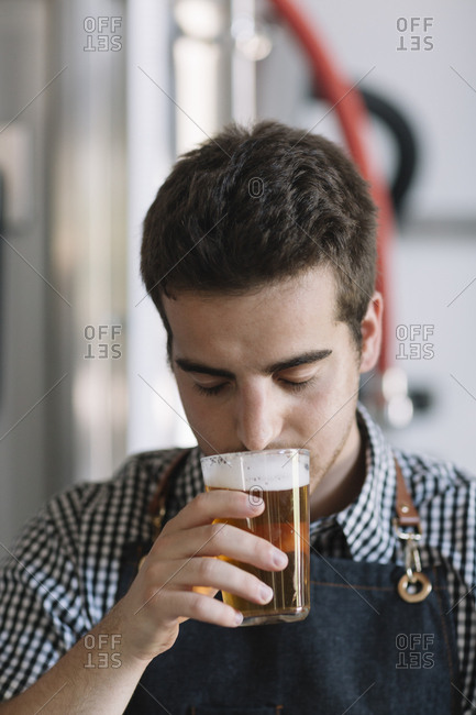Young man testing beer at a brewery