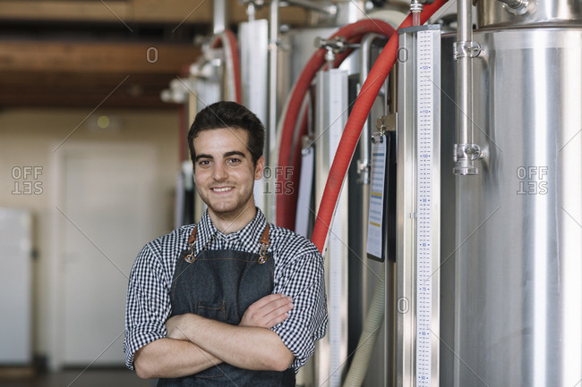 Portrait of confident young brewer at a brewery