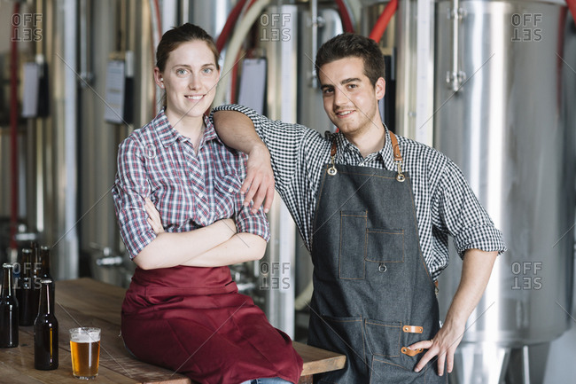 Portrait of confident young entrepreneurs at a brewery