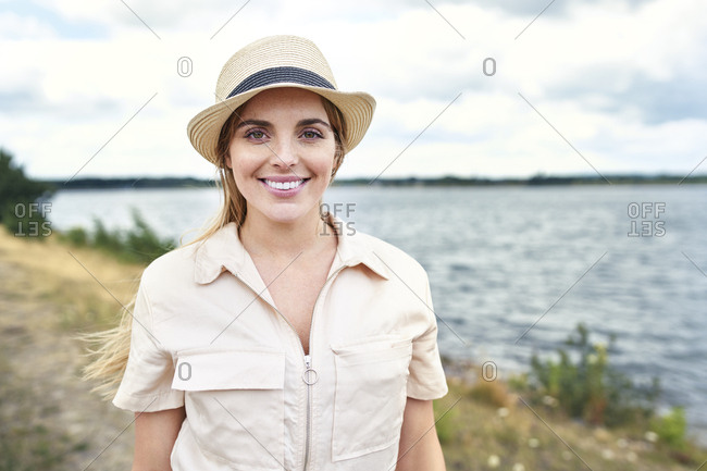 Portrait of smiling woman at the lakeside