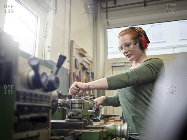 Woman working at a lathe