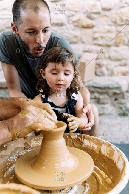 Father and daughter in a pottery workshop