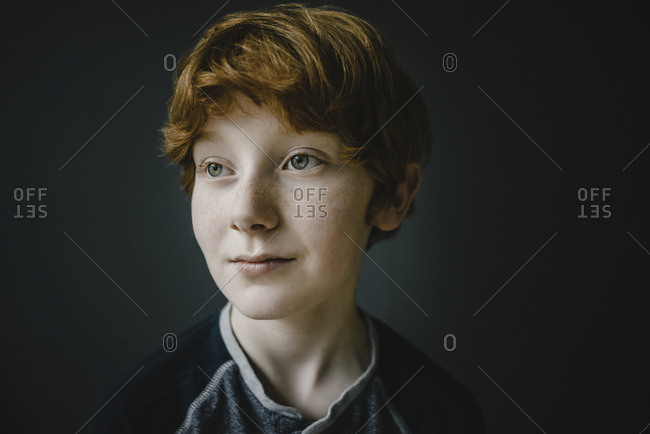 Portrait of redheaded boy with freckles