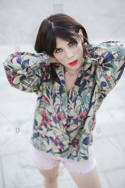 Portrait of young woman posing wearing patterned blouse