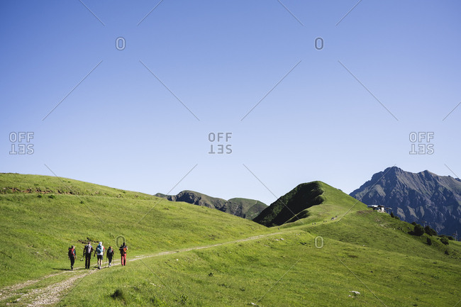 Group of hikers walking in the mountains- Orobie Mountains- Lecco- Italy