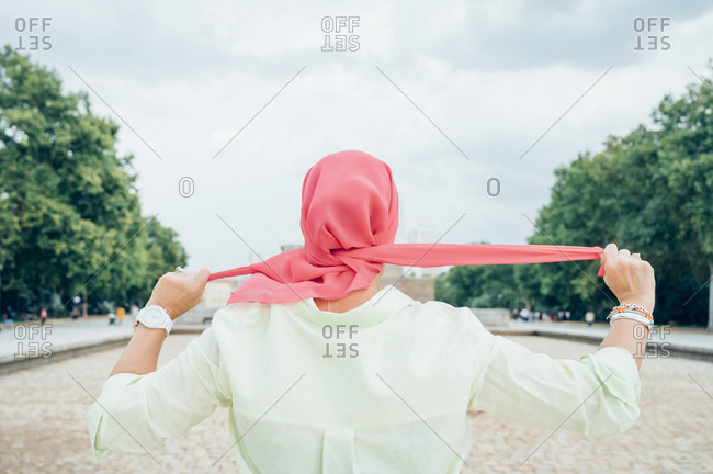 Rear view of woman with pink headscarf