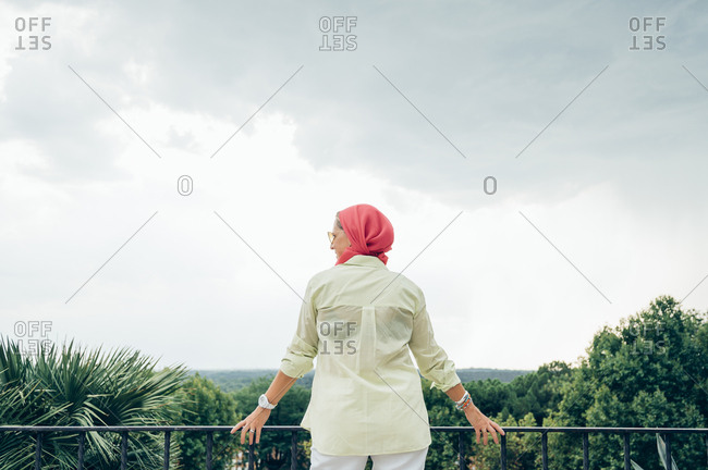 Senior woman with pink headscarf looking at view