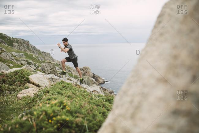 Trail runner in coastal landscape- Ferrol- Spain