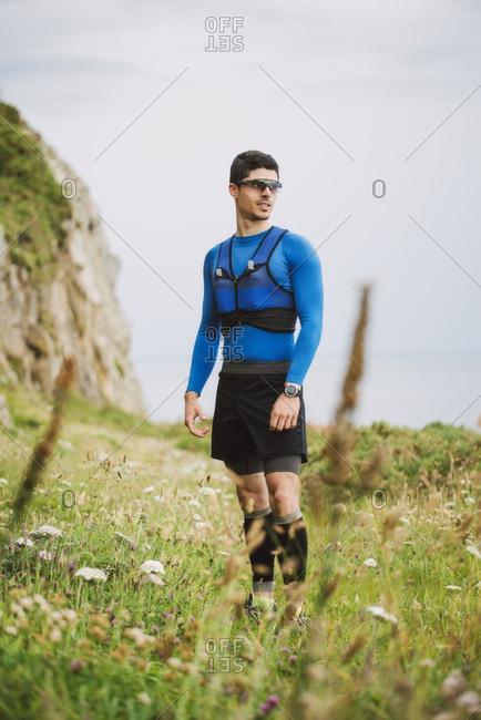 Trail runner standing in nature- Ferrol- Spain