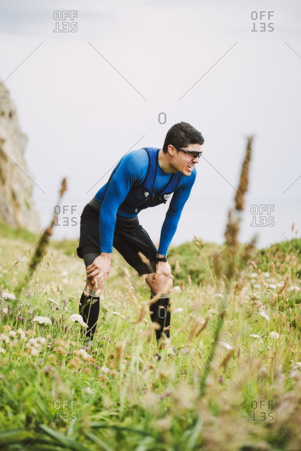 Exhausted trail runner standing in nature- Ferrol- Spain