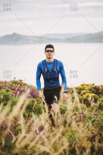 Portrait of trail runner in the mountains- Ferrol- Spain