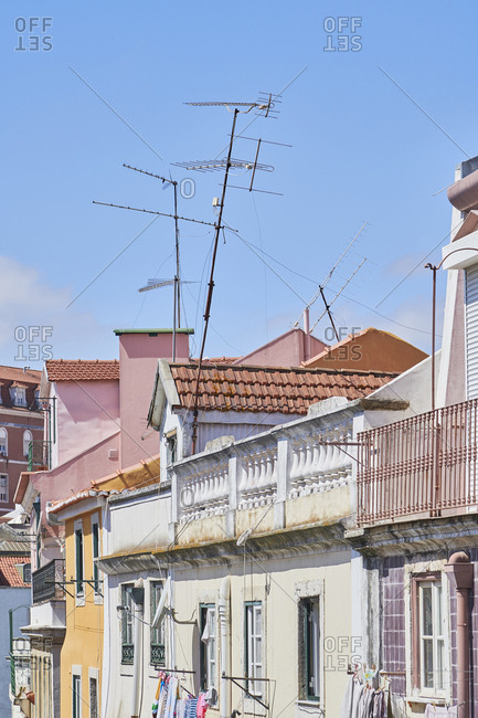 Facades of buildings and antennas in Mouraria, Lisbon, Portugal