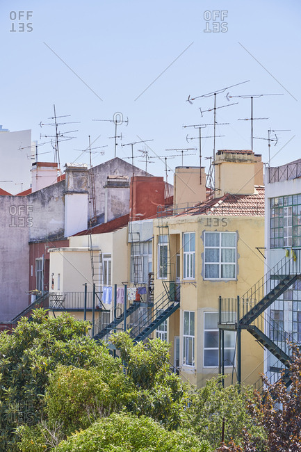 Colorful neighboring apartment buildings with antennas in Lisbon, Portugal