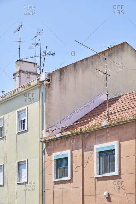 Neighboring apartment buildings with antennas in Lisbon, Portugal