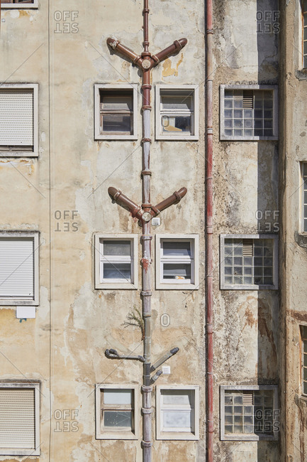 Lisbon, Portugal - September 6, 2019: Exterior of old apartment building with plumbing pipes on wall