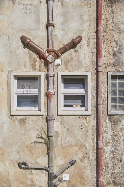 Lisbon, Portugal - September 6, 2019: Old apartment building with plumbing pipes on exterior wall