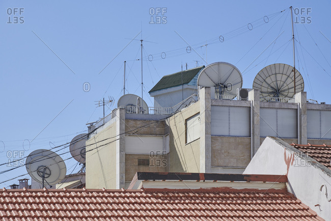 Buildings with antennas and satellite dishes in Lisbon, Portugal