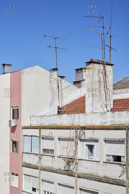 Exterior of buildings with antennas on rooftops, Lisbon, Portugal