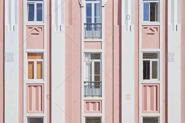 Pink detail of building in Bairro das Colonias in the Anjos neighborhood, Lisbon, Portugal