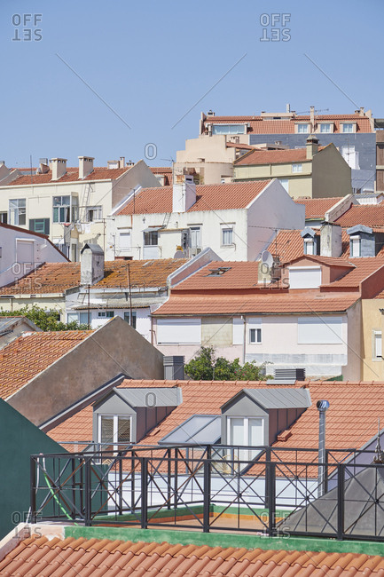Elevated view of neighboring buildings with red rooftops in Lisbon, Portugal