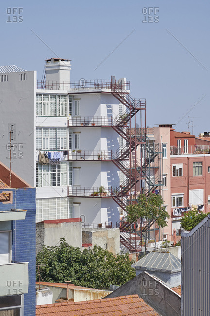 Apartment buildings in Lisbon, Portugal with tall fire escapes