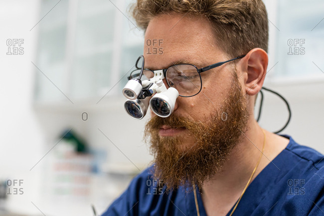 Vet surgeon doctor with beard and magnifying glasses