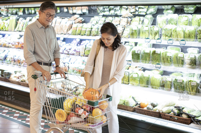 Mature Chinese couple shopping in supermarket