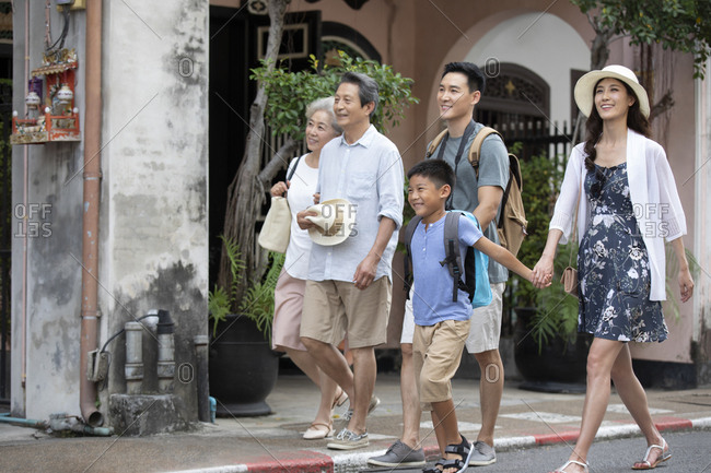 Happy Chinese family walking on street