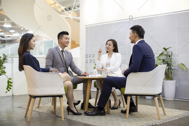 Chinese business people talking in office