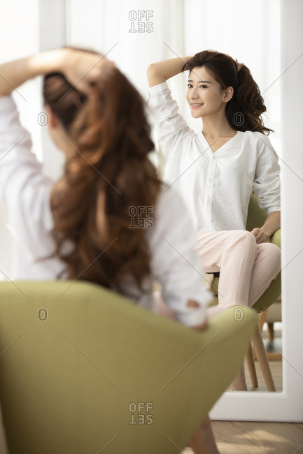 Young Chinese woman and hair care