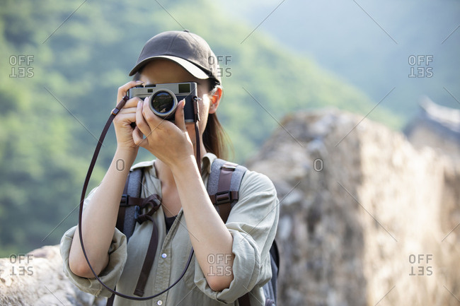 Chinese photographer taking photos outdoors