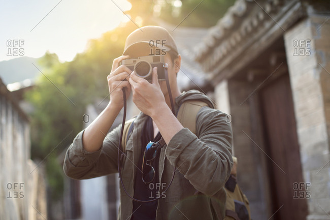 Chinese photographer taking photos in village