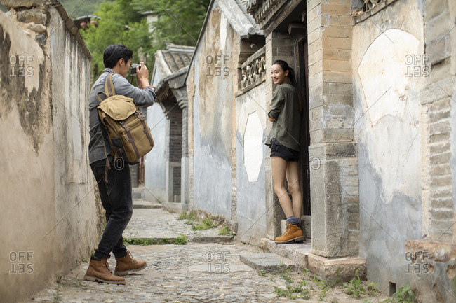 Young Chinese couple taking photos outdoors