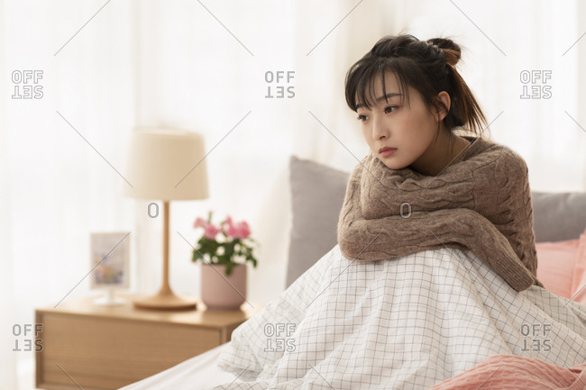 Young Chinese woman being unhappy at home