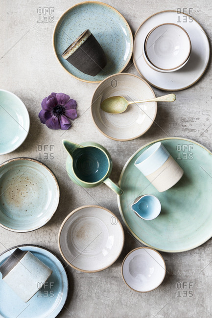 Top view of pastel ceramic plates and cups