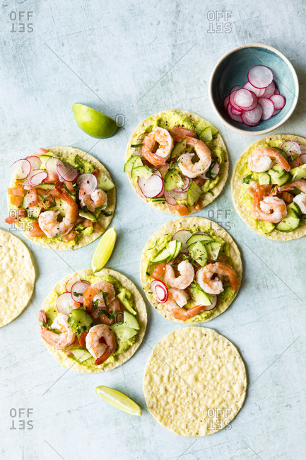 Shrimp tostadas with homemade guacamole, diced tomatoes and radish