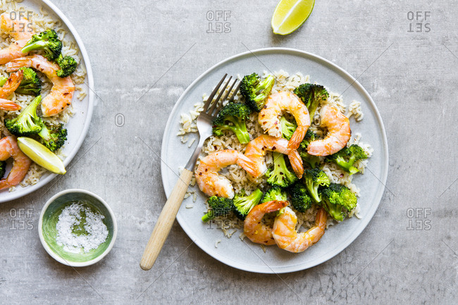 Plate of shrimp and broccoli stir fry with brown rice