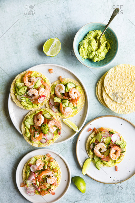 Shrimp tostadas served with homemade guacamole, tomatoes and radish