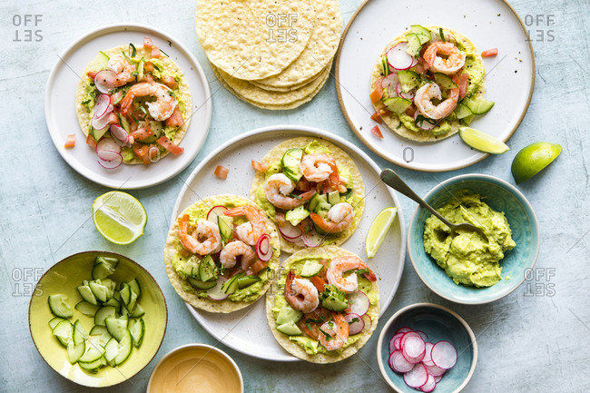 Shrimp tostadas served with guacamole and various toppings