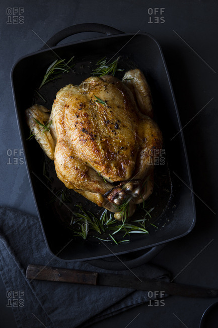 Whole roasted chicken in a cast iron pan