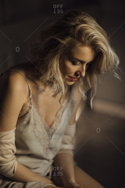 Beautiful woman fashion model posing in silky nightgown.