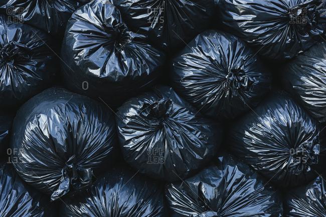 Pile of black plastic garbage bags.
