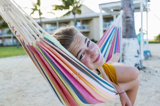 A teenage girl resting in hammock