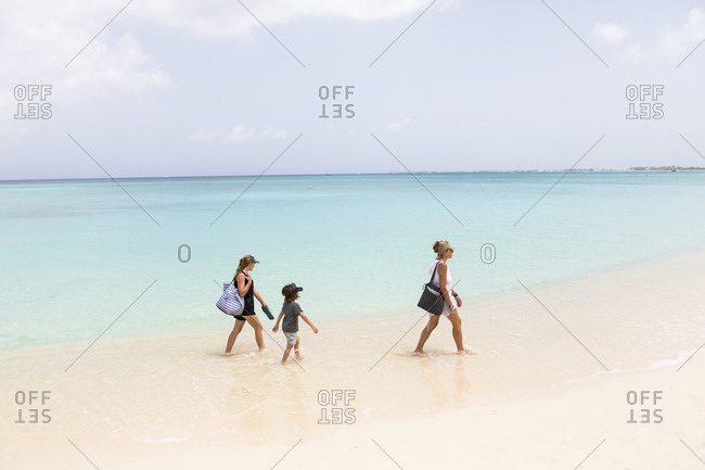 Mother and her children walking the beach