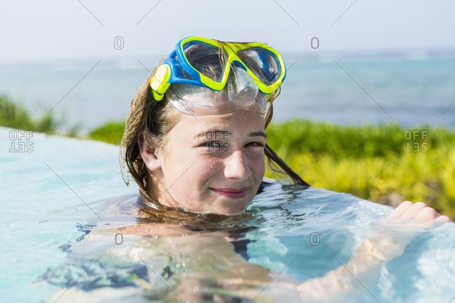 A teenage girl in an infinity pool