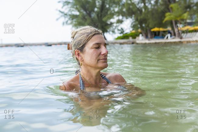 A mature woman relaxing in ocean water
