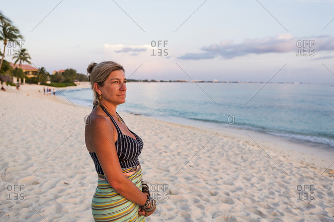 adult woman looking at setting sun