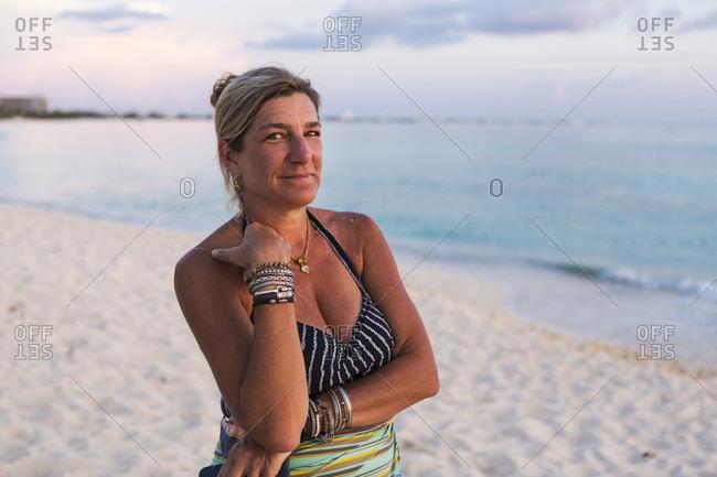 Adult woman looking at setting sun